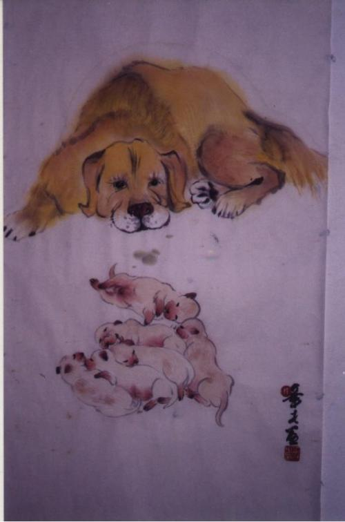 A Golden Retriever with her pups