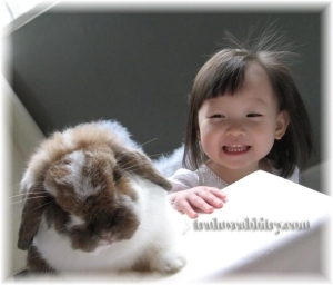She's always happy to have a bunny around...